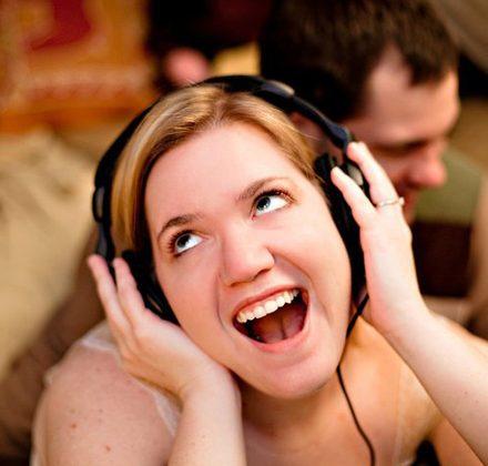holding-headphones-listening-to-music-8