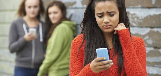 45009248 – teenage girl being bullied by text message