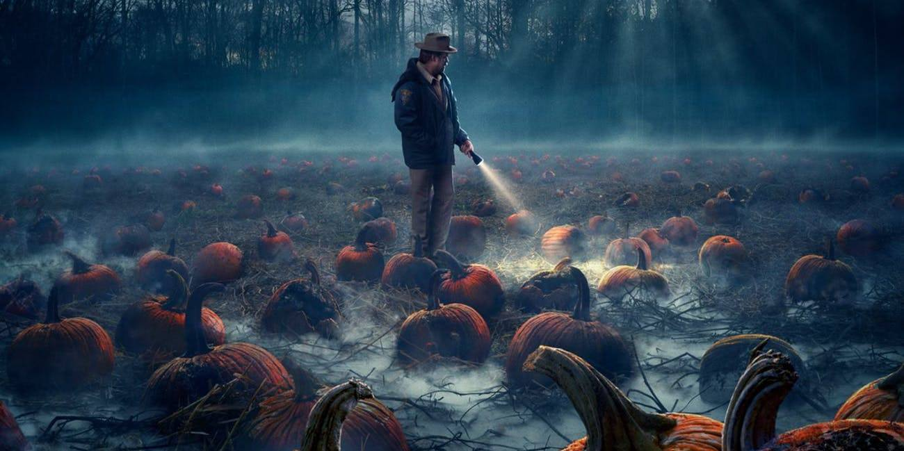 sheriff-hopper-surveying-some-of-the-infected-pumpkins-in-a-poster-for-stranger-things-season-2