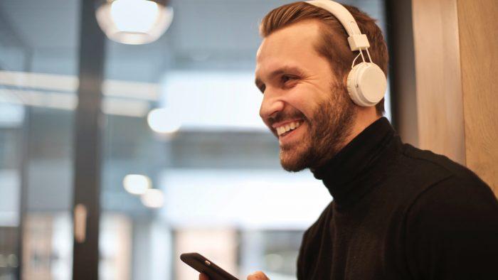 man-wearing-white-headphones-listening-to-music
