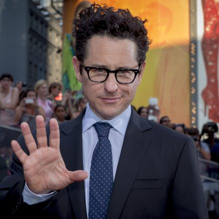 """Producer and director J.J. Abrams poses on the red carpet for a screening of the film """"Mission Impossible: Rogue Nation"""" in New York"""