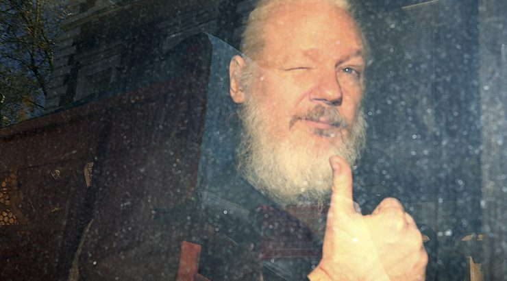 WikiLeaks founder Julian Assange arrives at the Westminster Magistrates Court, after he was arrested  in London