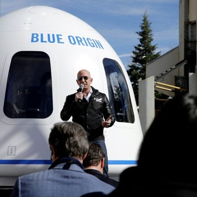 Image: FILE PHOTO: Amazon and Blue Origin founder Jeff Bezos addresses the media about the New Shepard rocket booster and Crew Capsule mockup at the 33rd Space Symposium in Colorado Springs